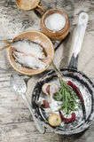 Two Roaches Fish In Ceramic Bowl With Salt. Royalty Free Stock Image