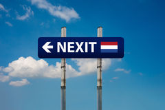 Two road signs, dutch elections nexit  and european union Royalty Free Stock Image