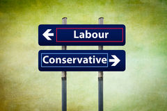 Two road signs representing labour and conservative parties in u. Concept of two road signs representing labour and conservative parties in uk early elections in Stock Photos