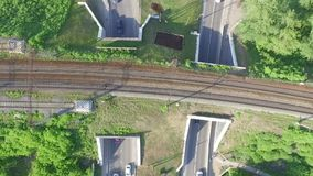 Two road tunnel which takes traffic from above railway tracks stock video