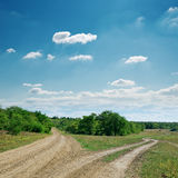 Two road under cloudy sky Royalty Free Stock Photos