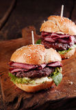 Two roast beef burgers on a takeaway counter Royalty Free Stock Photos