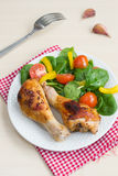 Two roasted chicken legs with salad Royalty Free Stock Photography