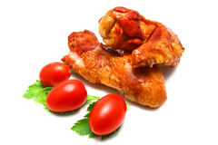 Two roasted chicken wing and tomatoes Royalty Free Stock Image