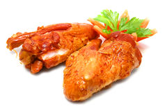 Two roasted turkey wings isolated over white Stock Photo