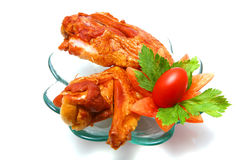 Two roasted turkey wings over white and cherry Royalty Free Stock Images