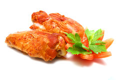 Two roasted turkey wings and tomato cut Stock Image