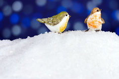 Two robin in the snow. Christmas winter robin figurine on snow Stock Photography