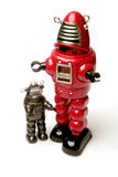 Two robots. In different sizes Stock Photos