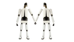Two robots hold hands Royalty Free Stock Photos