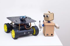 Two robots on on a white table  at home Royalty Free Stock Image