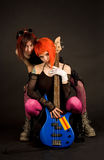Two rock girls with bass guitar. Rock girls with bass guitar isolated in studio royalty free stock photos