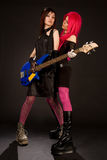 Two rock girls with bass guitar stock images