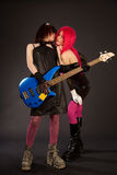 Two rock girls kissing Stock Photography