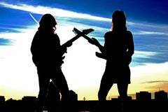 Two rock and roll women silhouette Royalty Free Stock Images