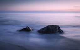 Two Rocks. At dusk, shallow depth of field, long exposure, Pacific coast, USA stock image