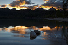 Two rocks in lake at sunset. Royalty Free Stock Photography