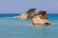 Two rocks in the sea on Corfu Stock Image