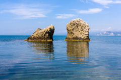 Two rocks in sea water Royalty Free Stock Photos