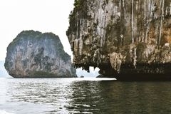 Two rocky islands in the Andaman sea. Image of two rocky islands with vegetation in the Andaman sea Stock Photography