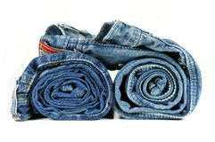 Two rolled blue jeans Stock Photography