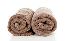 Two rolled brown towels Royalty Free Stock Photography