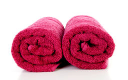 Two rolled red towels Stock Photo
