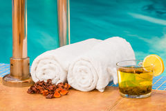 Two a rolled towels and a cup of tea Royalty Free Stock Photos