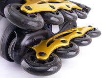 Two roller blades. Two roller skate blades on white background closeup Stock Photos