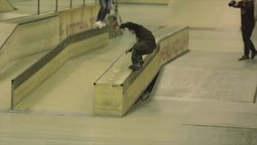 Two roller skaters grind on fence. Springboard. Extreme trick. Competition in skatepark. Cameraman. Slow motion stock video