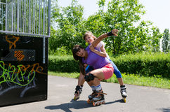 Two rollerbladers practising at the skate park Stock Photos