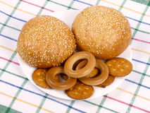 Two rolls, bagels and crackers Stock Image