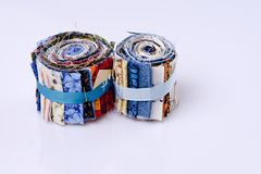 Two rolls of fabrics. Two rolls of colored pre cut fabrics. Many colors and patterns Royalty Free Stock Images