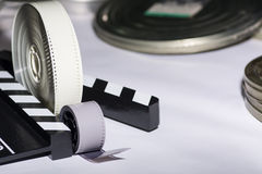 Free Two Rolls Of Film, Boxes Of Film And Movie Clapper Royalty Free Stock Image - 55194246