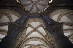 Two romanesque capitals. Inside architectural cenital view from vaults with two capitals in the forefront taken in the romanesque monatery of Carboeiro in the Stock Photo