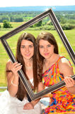 Two Romanian Models in a Picture Frame Royalty Free Stock Photo