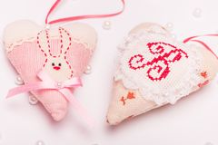 Two romantic beautiful heart with a hare and a bow on a pink background for a card. Two romantic beautiful heart with a hare and a bow on a pink background for a royalty free stock photos