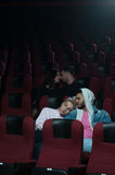 Two romantic couples in movie theater Royalty Free Stock Images