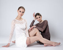 Two romantic girls posing in lace dresses Royalty Free Stock Photography