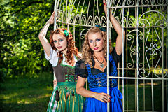 Two romantic girls wearing dirndl Stock Photo