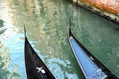 Two romantic gondolas on a Venetian canal Royalty Free Stock Photos