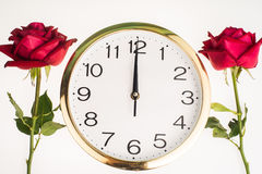 Two romantic red rose border and wall clock white background Royalty Free Stock Photo