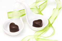 Two hearts with chocolate Stock Photos