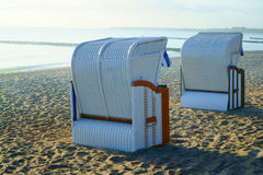 Two roofed wicker beach chairs at the baltic sea Royalty Free Stock Image
