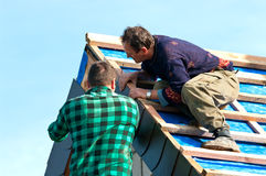 Two roofers at work Stock Photos