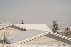 Two Roofs with Snow Royalty Free Stock Photos