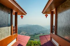 Two room of resort chinese tribe design with view tea plantation on hill and blue sky. At doi mae salong stock photo