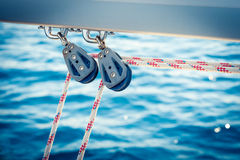 Two ropes and pulleys on boom Royalty Free Stock Image