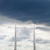 Two ropes rise to sky with rainy clouds Stock Images