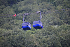 Two ropeway cabins nearby. Two ropeway cabins next to eaxh other in the summer Royalty Free Stock Photography